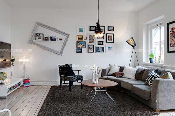 简约欧式客厅效果图:简欧的风格搭配上色彩斑斓的照片墙,既有提色
